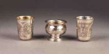 PAIR OF ENGRAVED RUSSIAN SILVER COLOURED METAL WINE BEAKERS, 0.84 standard, with gilt interiors,