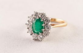 18ct GOLD, EMERALD AND DIAMOND OVAL CLUSTER RING, set with centre oval emerald approximately 10mm