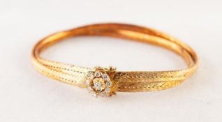 GOLD COLOURED METAL TWO STRAND BRACELET, the clasp surmounted by a cluster of ten small diamonds,
