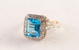 9ct WHITE GOLD RING set with an emerald cut blue topaz above a surround of eight tiny diamonds, 3