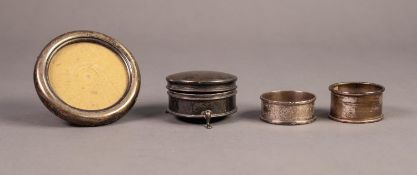 SILVER CIRCULAR TRINKET BOX with hinged lid, blue silk lined interior, raised on three feet, 2 1/4in