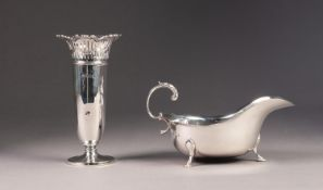 GEORGIAN STYLE SILVER SAUCEBOAT, with leaf capped flying handle and stepped pad feet, Chester