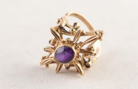 9ct GOLD AND AMETHYST DRESS RING collet set with an oval amethyst in an elaborate diamond shaped