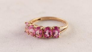 9ct GOLD RING claw set with a row of uniform oval pink stones, 2gms, ring size P