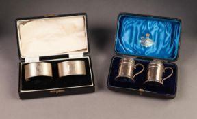 PAIR OF ART DECO ENGINE TURNED SILVER NAPKIN RINGS, of rounded oblong form, Birmingham Jubilee