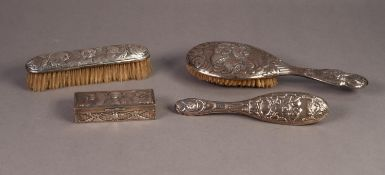 EDWARDIAN SILVER PIN BOX, the hinged lid and all sides repousse with winged cherubs, 4in (10.1cm)