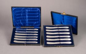 BOXED SET OF SIX AFTERNOON TEA KNIVES with floral embossed pointed silver handles, Sheffield 1915