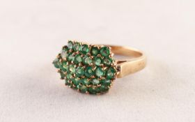 9ct GOLD AND EMERALD DOMED OVAL CLUSTER RING, having five rows of tiny emeralds, twenty nine in all,