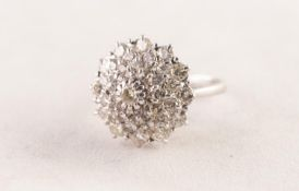WHITE GOLD COLOURED METAL AND DIAMOND DOMED CIRCULAR CLUSTER RING set with a circular centre diamond