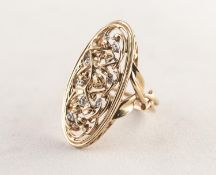 9ct YELLOW AND WHITE GOLD RING, the large oval openwork top formed of foliate scrolls with white