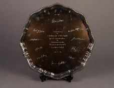 MODERN SILVER PRESENTATION SALVER, with gadrooned border to the wavy outline, raised on claw and