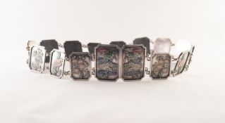 CHINESE SILVER AND ENAMELLED BELT with fourteen large panel links with cave relievo with