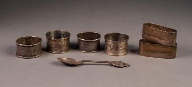 PAIR OF FOLIATE SCROLL ENGRAVED AND INITIALLED SILVER NAPKIN RINGS; two other pairs of SILVER NAPKIN