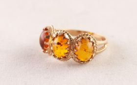 9ct GOLD RING with three cabochon oval golden amber, each in a multi claw setting, 3.8 gms, ring