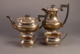 GEORGE VI SILVER FOUR PIECE TEA SET BY EDWARD VINERS, of bellied, rounded oblong form with black