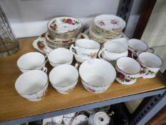 ENGLISH FINE BONE CHINA TEA SET FOR SIX PERSONS, WITH PRINTED DECORATION OF FLORAL SPRAYS, 21 PIECES