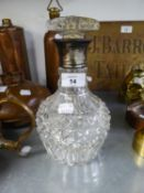 A HEAVY CUT GLASS BULBOUS WINE DECANTER WITH SILVER NECK AND GLASS MUSHROOM STOPPER, LONDON HALLMARK