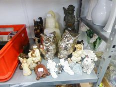 A LARGE, RESIN SEATED FAIRY ORNAMENT, BATTERY ILLUMINATED; TWO SMALL RESIN FAIRY ORNAMENTS; TWO