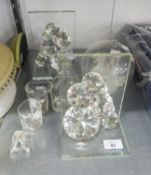 A PAIR OF JULIAN MACDONALD FACETED CUT GLASS BOOKENDS; A FACETED GLASS HEART SHAPED PAPERWEIGHT;