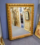 "A LARGE UPRIGHT WALL MIRROR, IN FRUITING VINE EMBOSSED FRAME, 4'6"" HIGH (SMALL SECTION OF FRAME"