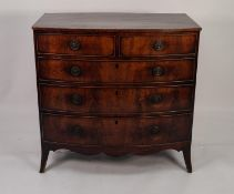 EARLY NINETEENTH CENTURY MAHOGANY BOW FRONTED CHEST OF DRAWERS, the shaped top above two short and
