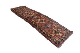 SHIRAZ PERSIAN RUNNER with eight splash pattern medallions in blue and fawn on a wine red and floral
