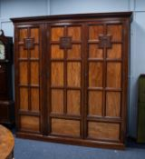 GOOD QUALITY LATE VICTORIAN FIGURED MAHOGANY THREE DOOR WARDROBE, the moulded cornice above three