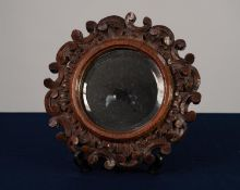 VICTORIAN CARVED OAK SMALL WALL MIRROR, the circular, bevel edged plate within a frame outlined with