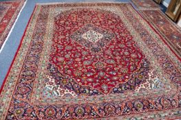 KASHAN PERSIAN CARPET with lozenge shaped centre triple concentric medallion with pendants, on a