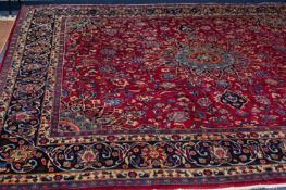 MESHED PERSIAN CARPET with floral and petal shaped circular centre medallion with pendants and