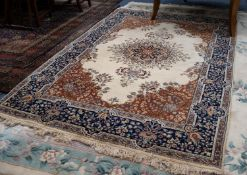 FINELY KNOTTED KIRMAN CARPET, the elaborated radiating floral circular centre medallion having