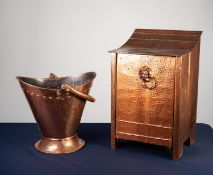 EARLY TWENTIETH CENTURY PLANISHED COPPER COAL PURDONIUM, with downswept top and captive lion mask