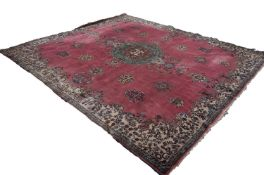 LARGE, POSSIBLY EUROPEAN, PERSIAN STYLE CARPET, having a rose pink field, large green, brown and
