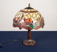 MODERN TIFFANY STYLE TABLE LAMP, the patinated base moulded with leaves, beneath a domed and