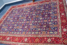 TABRIZ PERSIAN CARPET with all-over repeat formal floral, leaf and ram's horn patetrn on a dark blue