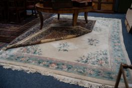 CHINESE EMBOSSED CARPET, with floral design and spandrels on an ivory field, pale blue and floral