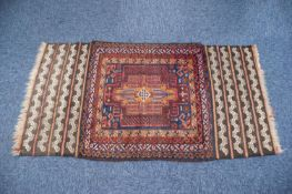 SHIRAZ PERSIAN RUG, the all wool pile centre section filled with a large rectangular medallion