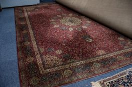 GROSVENOR WILTON ALL WOOL PILE BORDERED CARPET OF PERSIAN DESIGN, with radiating circular centre