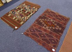 HAKKAKI KELIM RUG, with ladder stripes, the broad centre panel with large latch hook medallion