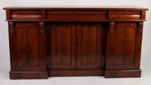 EARLY NINETEENTH CENTURY FIGURED MAHOGANY SIDEBOARD, the moulded oblong top above three concave
