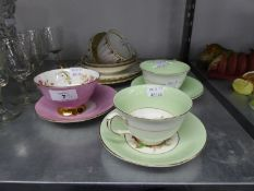 TWO TRIOS OF 19TH CENTURY FLUTED CHINA TEACUPS, SAUCERS AND SIDE PLATES AND THREE CHINA SPECIMEN