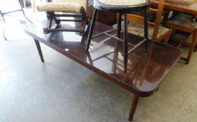 A LARGE OBLONG MAHOGANY COFFEE TABLE WITH QUADRANT CORNERS, ON POST SUPPORTS, 5? X 2?2? , WITH PLATE