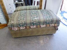 A LARGE UPHOLSTERED BEDDING BOX WITH HINGED LID