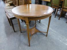 AN EDWARDIAN MAHOGANY INLAID CIRCULAR OCCASIONAL TABLE WITH UNDERTIER