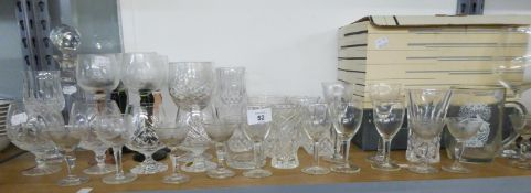 A SELECTION OF CUT AND PLAIN STEM WINE GLASSES AND BRANDY BALLOONS AND A SPIRIT DECANTER