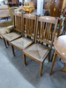 A SET OF SIX OAK DINING CHAIRS IN THE STYLE OF LIBERTY'S WITH RUSH SEATS  (6)