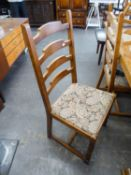A SET OF 6 OAK LADDER BACK DINING CHAIRS, WITH DROP-IN SEATS COVERED IN FLORAL TAPESTRY, ON TURNED