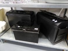 BLACK DEED BOX AND TWO LARGE BRIEFCASES (3)