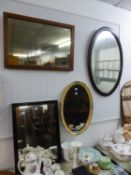TWO FRAMED OVAL WALL MIRRORS AND TWO OBLONG WALL MIRRORS (4)