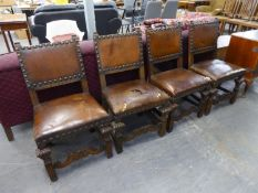 A SET OF FOUR 1930's OAK DINING CHAIRS, WITH LEATHER OVERSTUFFED SEATS AND STUDDED FINISH, LEATHER